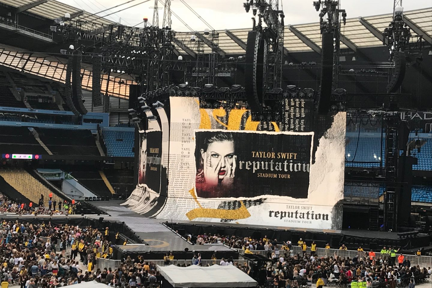 A photo of the stage at the Etihad stadium and the Reputation stadium tour logo on the screen