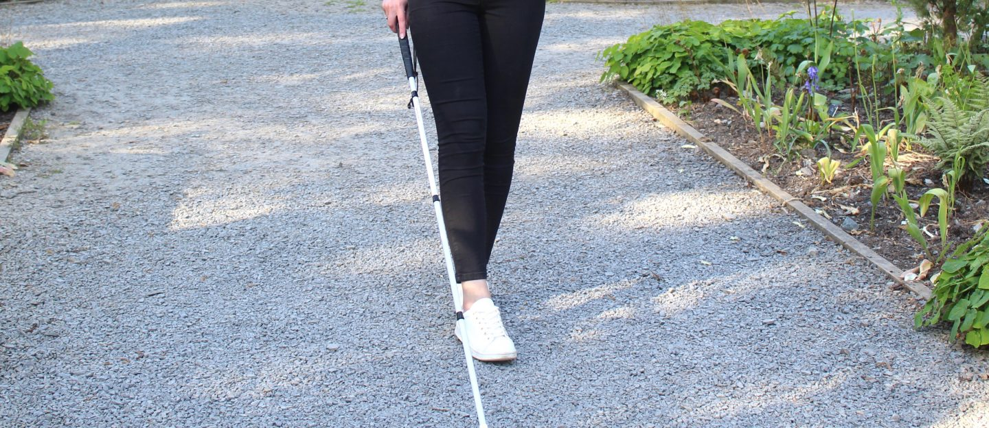8 ways you can help a blind/VI person: A photo of Elin using her cane