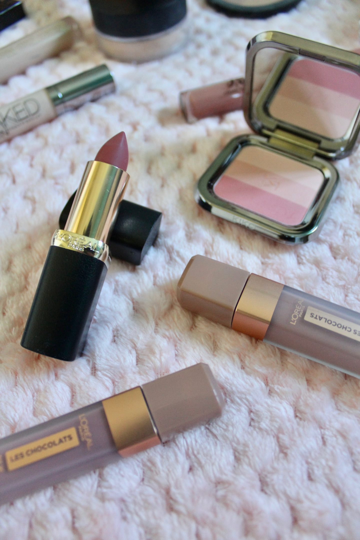 A photo of one of the l'oreal colour riche lipsticks and two of their new chocolate liquid lipsticks