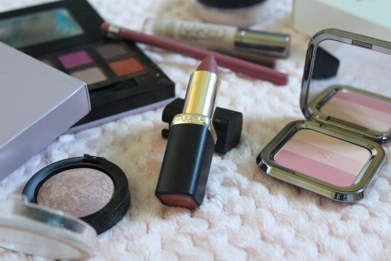 A photo of one of the l'oreal colour riche lipsticks, a max factor blush and a kiko colour fusion blush