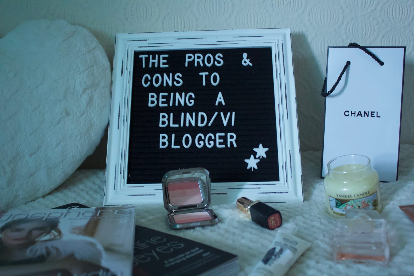 A white framed felt letter board which says the pros and cons to being a blind/VI blogger